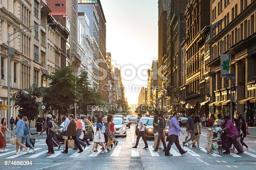 813211754 istock photo People Crossing Street in New York City 874686094