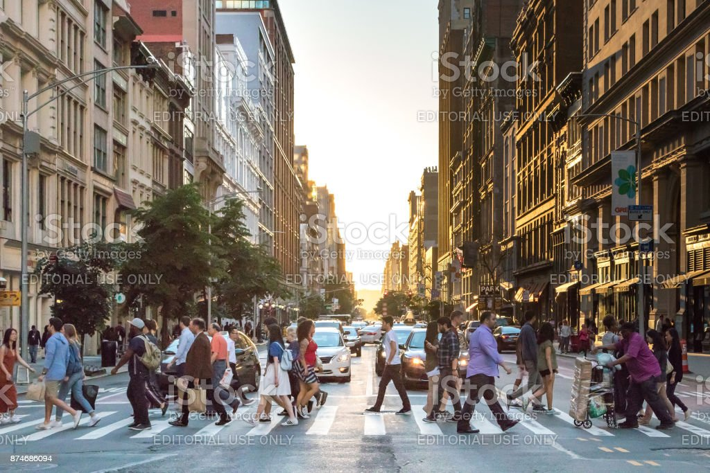 People Crossing Street in New York City stock photo