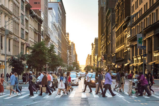 people crossing street in new york city - crowded stock pictures, royalty-free photos & images