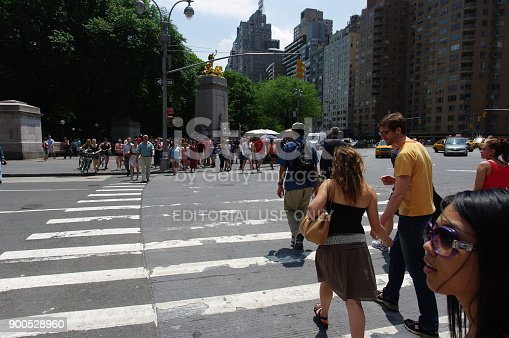 813211754 istock photo People Crossing Street in New York City 900528960