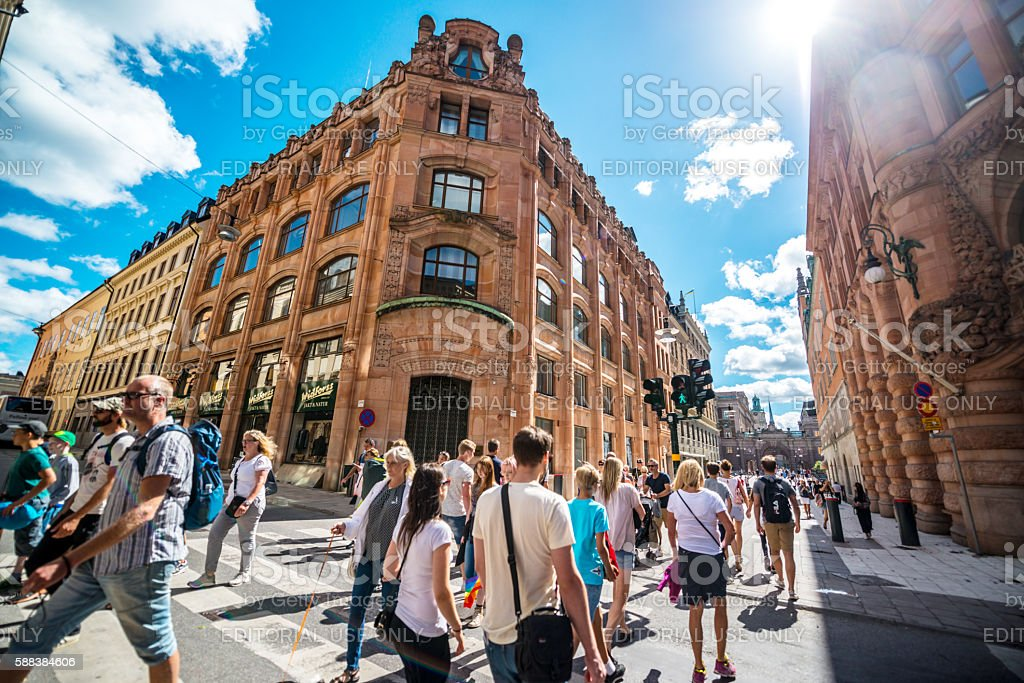 People crossing street in Stockholm, Sweden stock photo