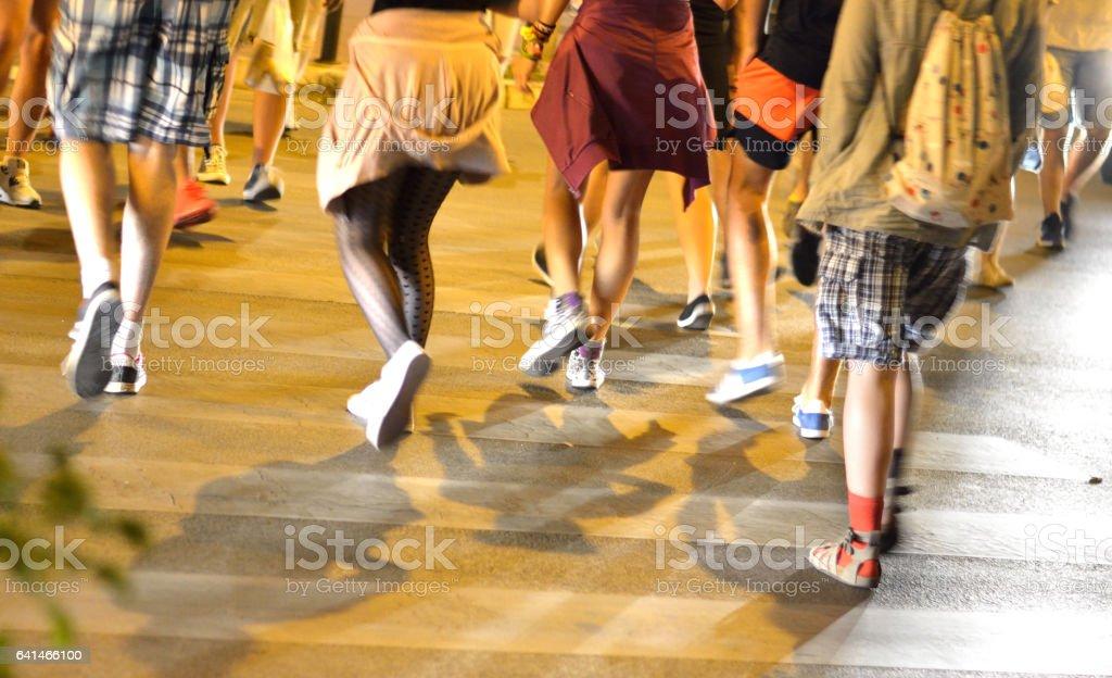 People crossing street on pedestrian crosswalk stock photo
