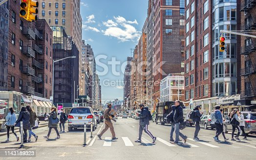 01 April 2019: Local people are crossing 7th Avenue, Manhattan, New York, USA. Manhattan is world's major commercial, financial and cultural center and the most densely populated of New York City's 5 boroughs.