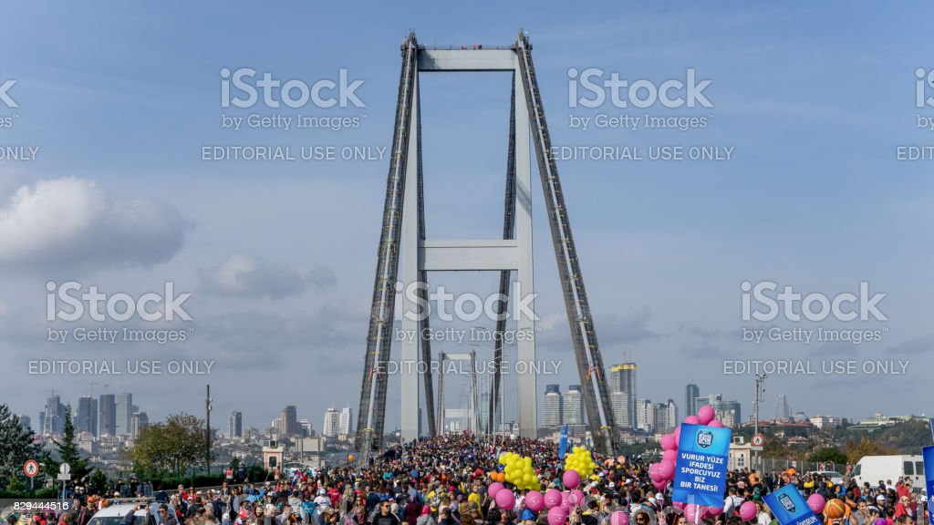 People crossing the bridge during Vodafone Istanbul Marathon. stock photo