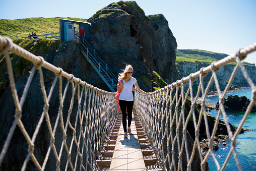 istock People crossing the Carrick-a-Rede Rope Bridge in County Antrim 472049623