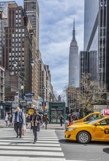 People Crossing The Eighth Avenue in Manhattan, New York, USA stock photo