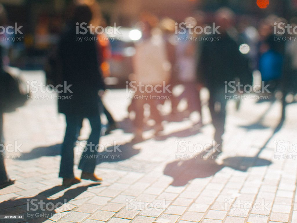People Crossing the Road at Sunset in London stock photo