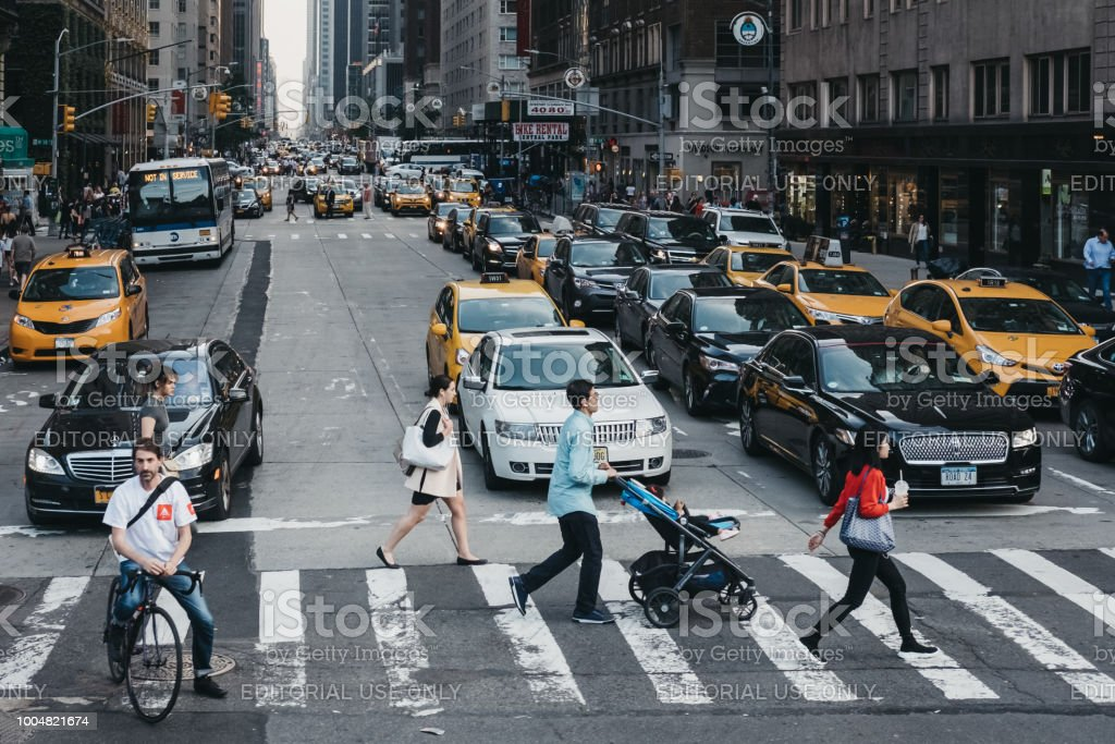 People crossing the road on a zebra crossing in New York, USA. New...