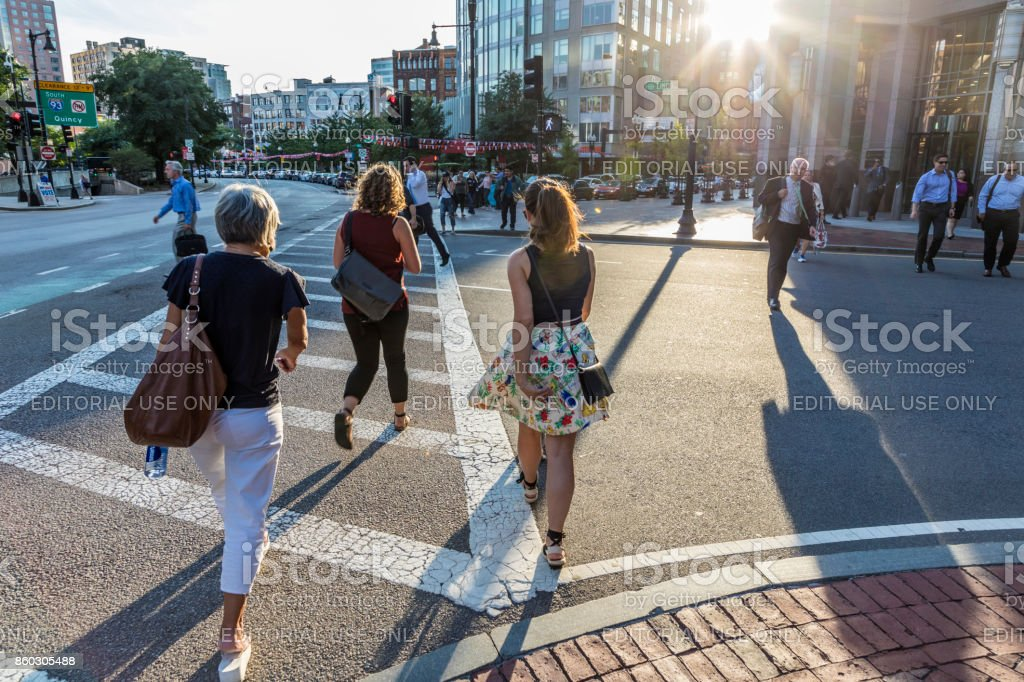 people crossing the street at a pedestrian crossing stripe downtown Boston stock photo