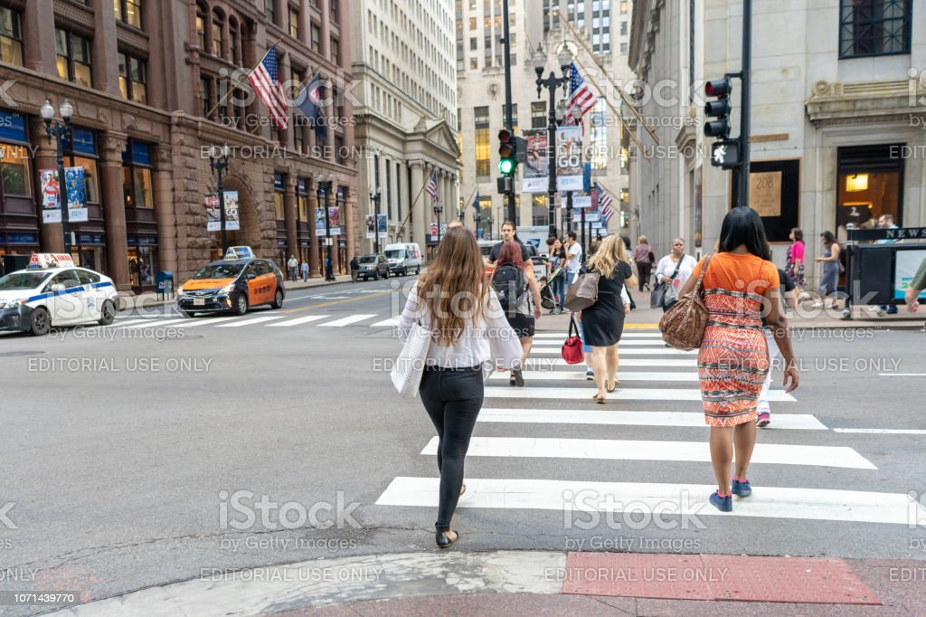 People crossing the street downtown Chicago near CBOT stock photo