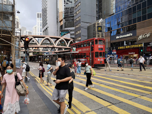 People crossing the street in Causeway Bay, Hong Kong island stock photo
