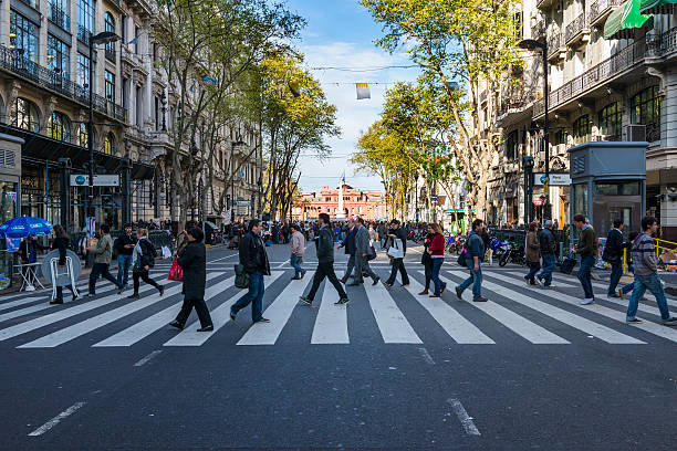 People crossing the street in the Avenida de Mayo in Buenos Aires stock photo