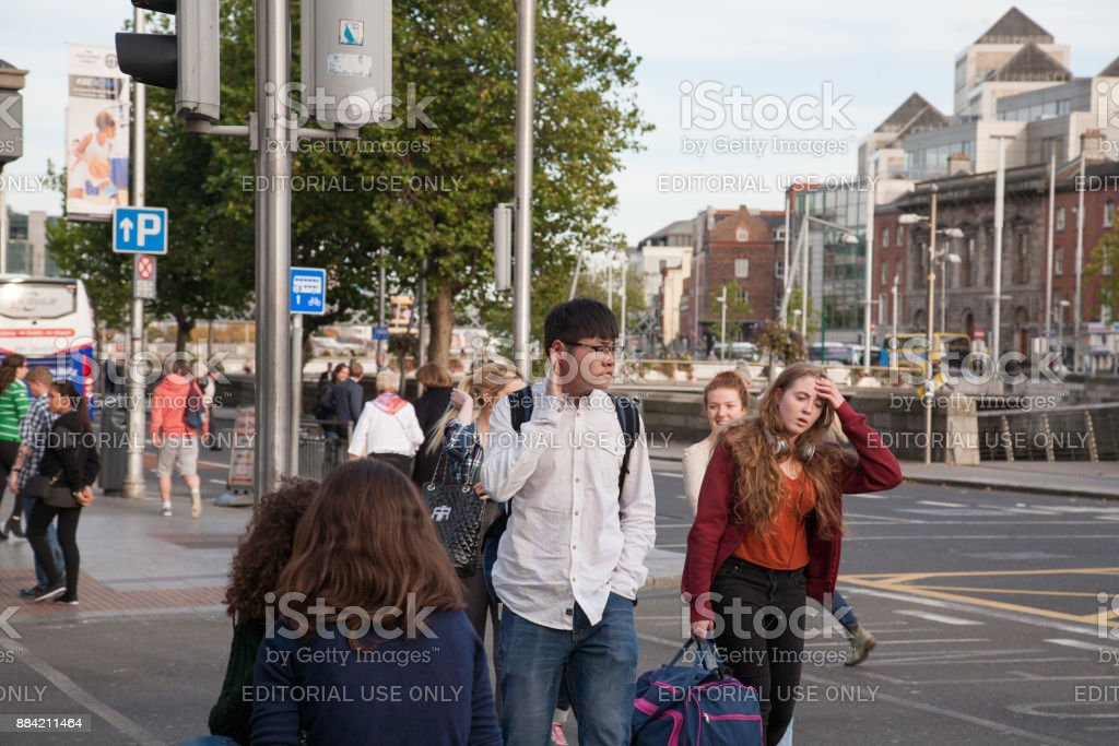 People crossing the street near O'Connell bridge. stock photo