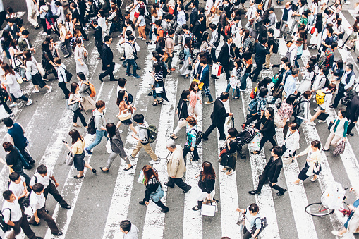People crossing the street on walkway