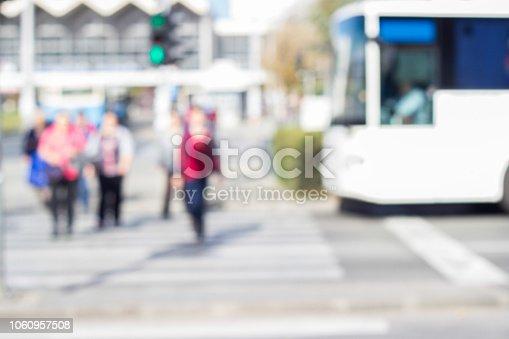 1060957508 istock photo People crossing the street 1060957508