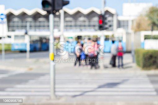 1060957508 istock photo People crossing the street 1060958756