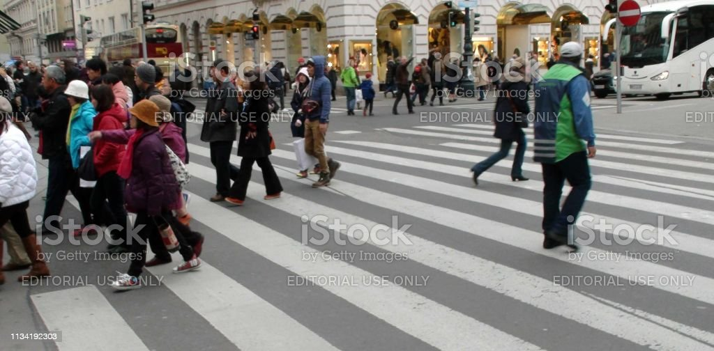 View Of Land Vehicle, Building Exterior, People Walking Back And...