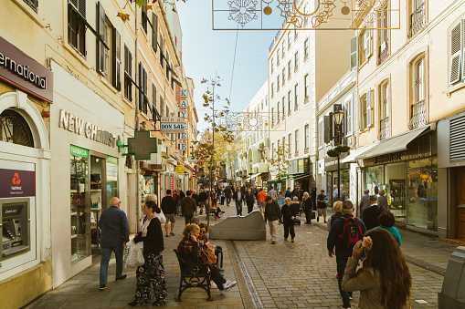 Gibraltar, Spain/United Kingdom - November  8, 2019: People crowd and roaming between shops and stalls on the main street of Gibraltar Gibraltar is a British Overseas Territory and headland, on Spain's south coast