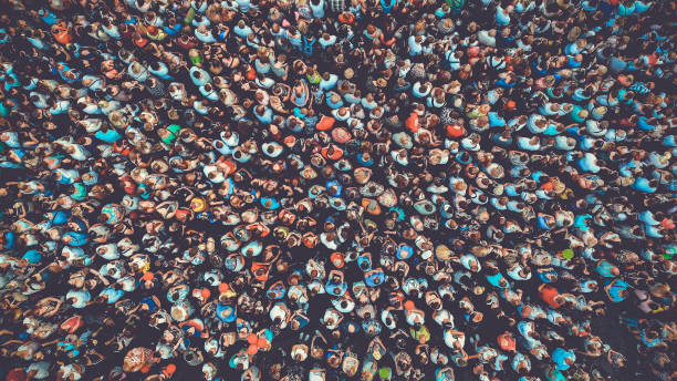 people crowd texture background. bird eye view. toned. - crowded stock pictures, royalty-free photos & images