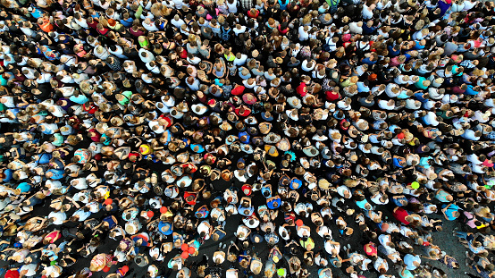 People crowd texture background. Top view from drone.