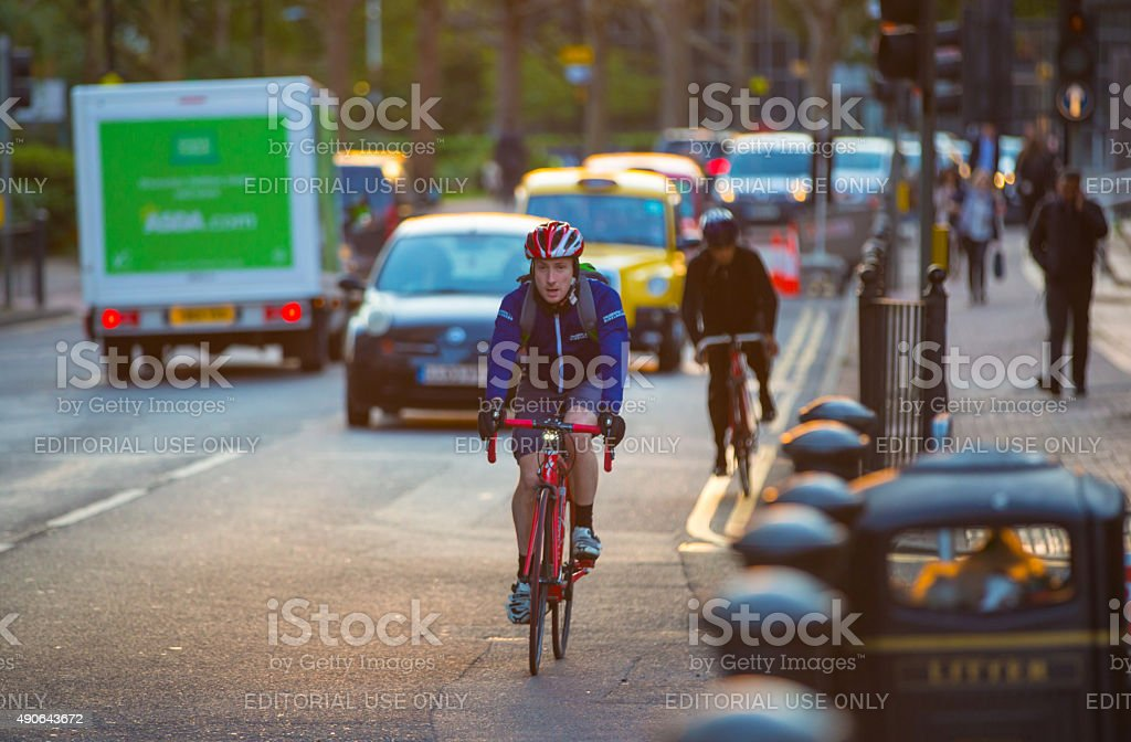 People cycling from the work, London stock photo
