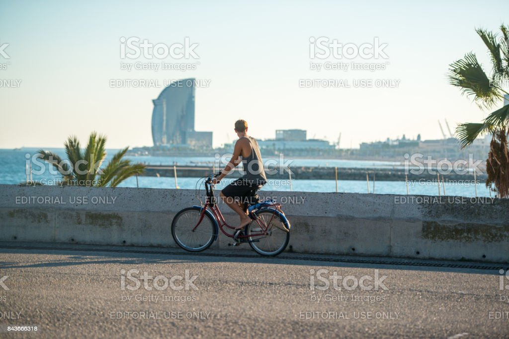 People cycling in Barcelona, Spain stock photo