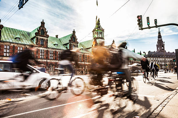 people cycling in copenhagen - denmark stock photos and pictures