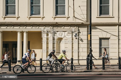 istock People cycling on a street in Pimlico, London, UK, during golden hour. 1167199001