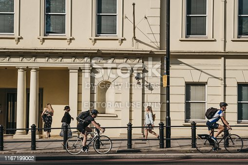 istock People cycling on a street in Pimlico, London, UK, during golden hour. 1167199002