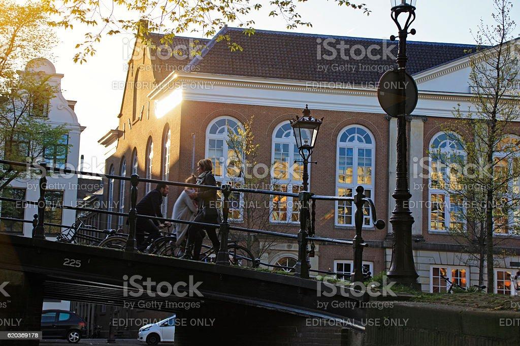 People Cycling Through a bridge in Amsterdam, Netherlands zbiór zdjęć royalty-free