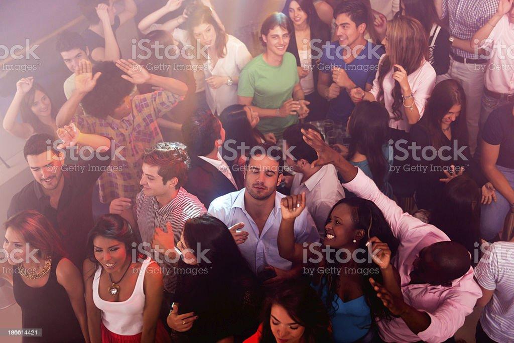 People dacing at a nightclub stock photo