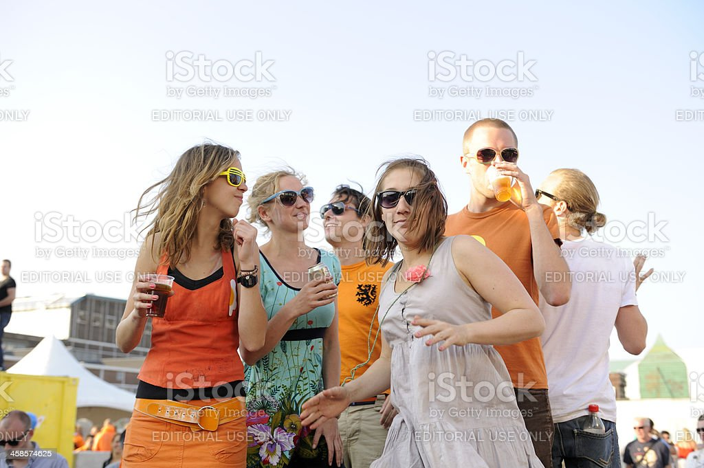People dancing at an outdoors party on Queen's day royalty-free stock photo