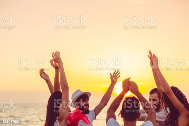 People dancing at the beach with hands up concept about party music picture id656047992?b=1&k=6&m=656047992&s=612x612&h=4yrcn3bgnmeer6ddofmqwwqxwdjcjfwjnnzcr nfb80=
