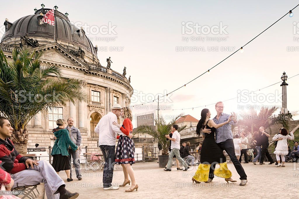People dancing by Museum Island in Berlin stock photo