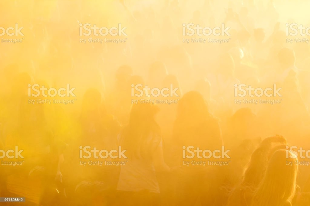People dancing during Colorful Holi Festival. stock photo