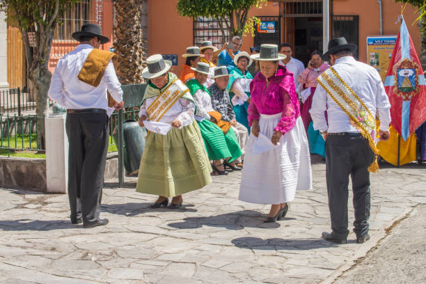 People dancing in the street during the celebration of the Palm Sunday of Easter in Ayacucho city, Peru. stock photo