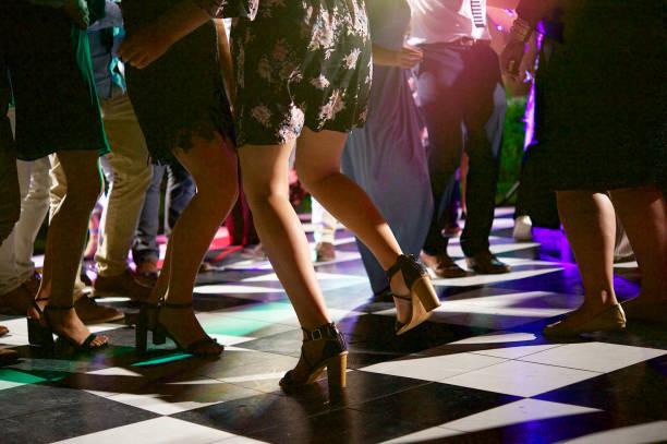 people dancing on the dance floor night - dance floor stock photos and pictures