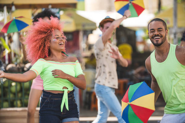 people dancing on the street - dance group stock photos and pictures