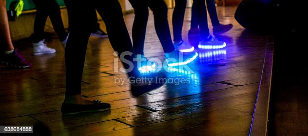 people dancing in theatrical stage with colorful LED iluminadop in