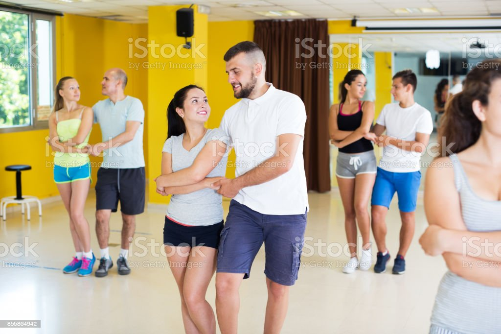 People dancing salsa in studio stock photo