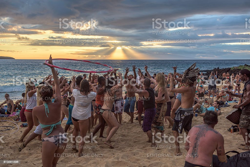 People dancing to a drum circle on Little Beach, Maui stock photo
