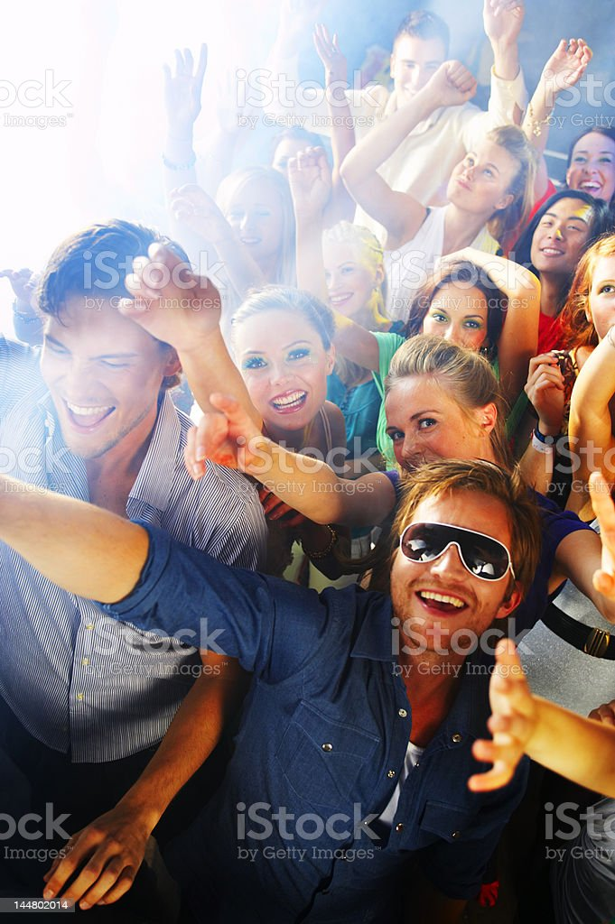 People dancing to the music at a nightclub royalty-free stock photo