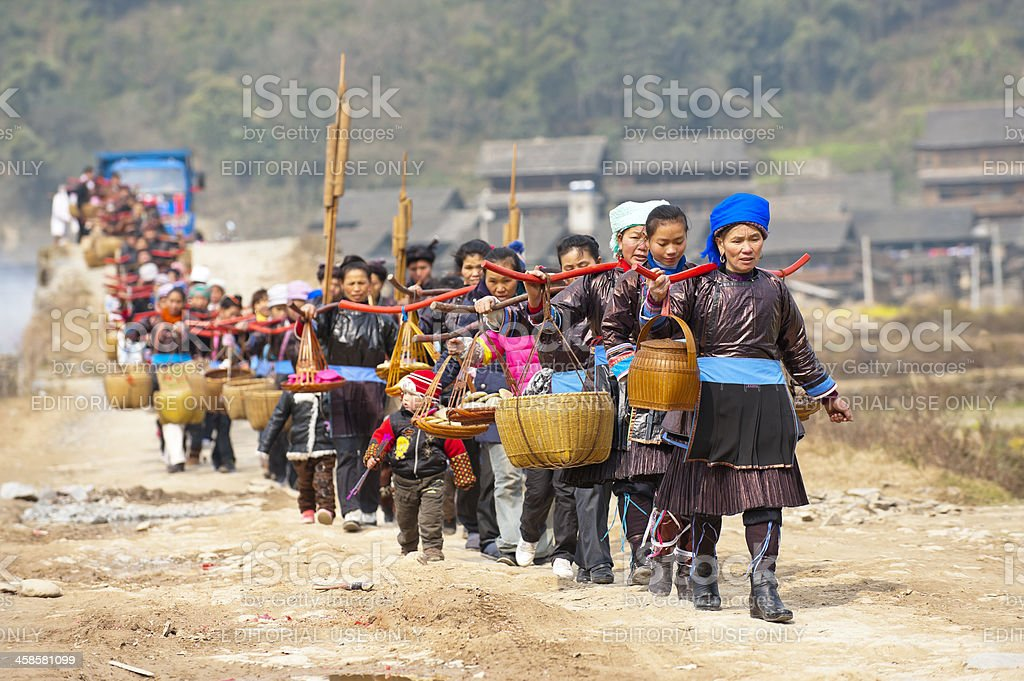 People delivering betrothal gifts on the road in country, China stock photo