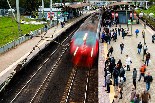 people depart home on train Moscow,Russia - September 26, 2016: Moscow,Russia-September 26 ,2016: after the end of working day,  people depart home on train depart stock pictures, royalty-free photos & images