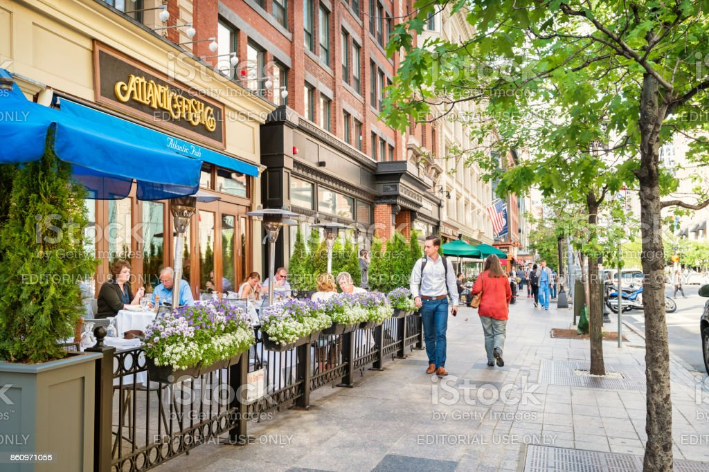 People dine at restaurant patio in Back Bay area of Boston Massachusetts USA stock photo