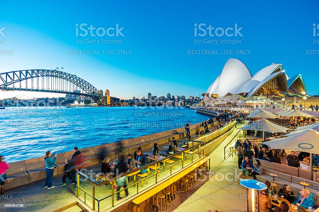 People dining at outdoor restaurants in Circular Quay in Sydney stock photo