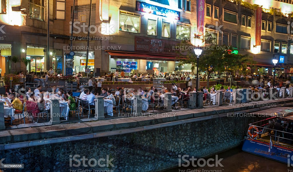 People Dining Outdoors In Clarke Quay, Singapore stock photo