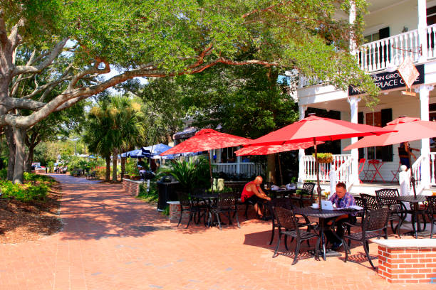 People dining outside a restaurant in Henry C. Chambers Waterfront Park in Beaufort, SC USA stock photo