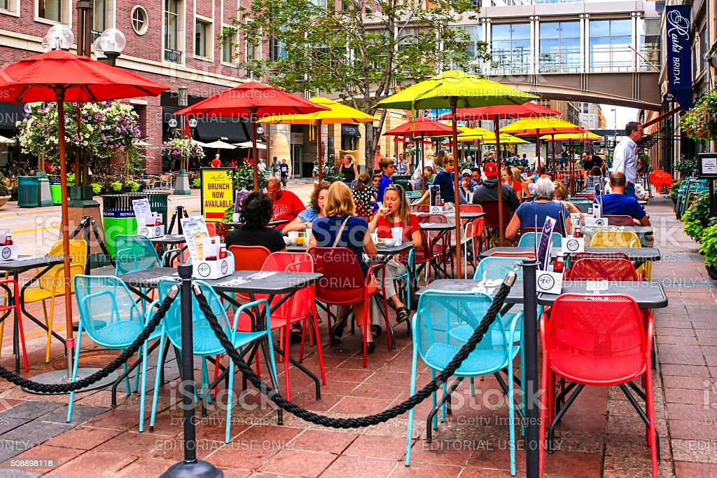 People dining outside a restaurant on Nicollet Mall Minneapolis MN stock photo