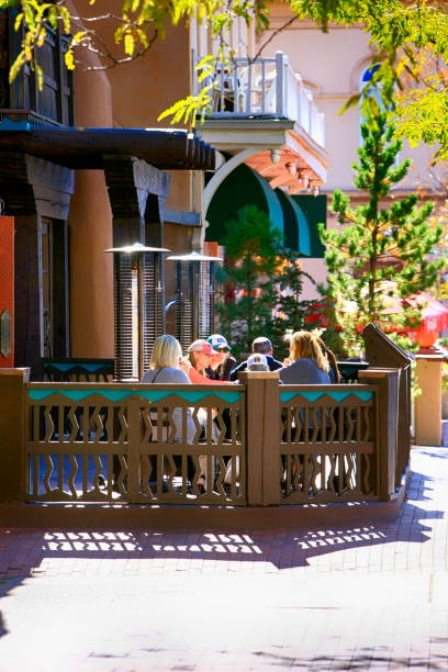 People dining outside the Low n' Slow Lowrider Bar on Washington Ave in downtown Santa Fe, New Mexico, USA stock photo